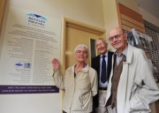 From left: Society members Bridget Patrick, John Ellwood and Brian Patrick with the newly-placed 'wall of fame' sign