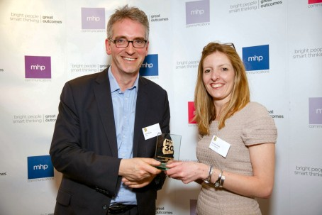 Annabelle receiving her award from Gavin Devine, the chief executive of MHP