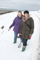 Arran Banner chief reporter Jennifer Lyon (right) out taking pictures of the heavy snowfall, before she managed to reach the paper's offices