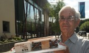 Advertiser reader Geoff Havers with his recreation of Leatherhead Leisure Centre, outside the real thing