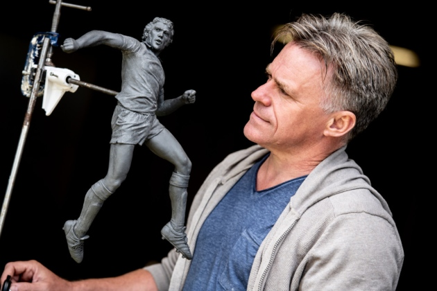 Sculptor Sean Hedges-Quinn working on the maquette of the Kevin Beattie statue