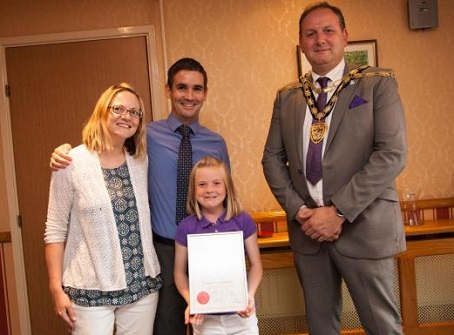 Ben Black is pictured with wife Alison and daughter Mollie receiving his award from Mayor Giles Davies.