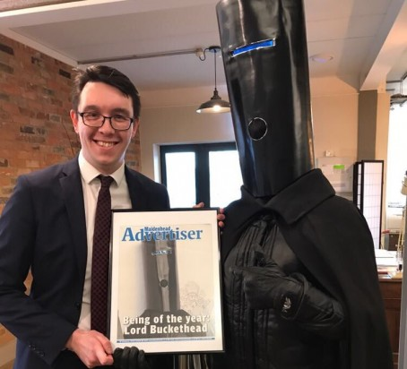 Lord Buckethead receives the award from Advertiser reporter James Harrison