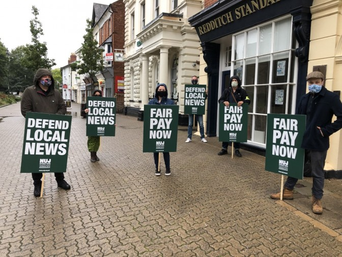 Striking journalists outside the office of the Redditch Standard this morning