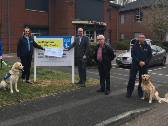 Chad editor Ashley Booker, pictured centre, and former Chad journalist Tony Spittles, second right, hand over the latest £15,000 cheque to representatives from the Guide Dogs charity