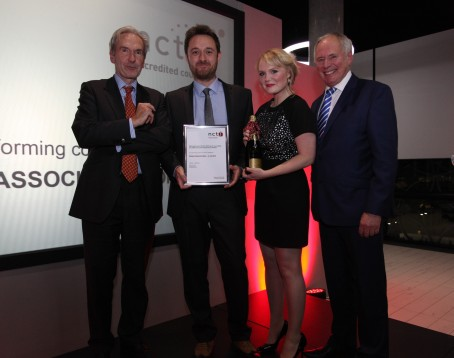 James Toney and Rachel Bull of News Associates (centre) receive their award from NCTJ chairman Kim Fletcher (left) and BBC presenter Nick Owen.