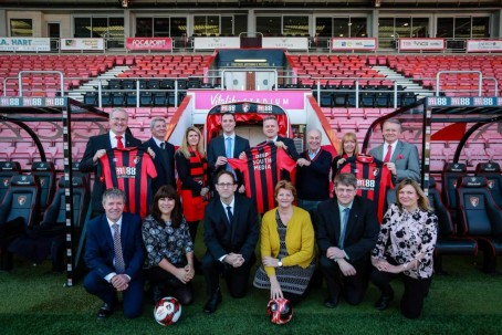 The Deep South team at AFC Bournemouth's Dean Court ground. From left: Cliff Moore, Mike Ribbeck, Alison Latta, Bournemouth commercial director Rob Mitchell, Ron Wain, Bournemouth chairman Jeff Mostyn, Debbie Granville, Andrew Diprose. Front row: Scott Sinclair, Debbie Moore, James Tourgout, Kay Sinclair, Ed Baker, Rachel Read.