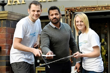 Chris, left, and Rachel, right, with Eddie Rathour, of sponsor The Fat Cat bar