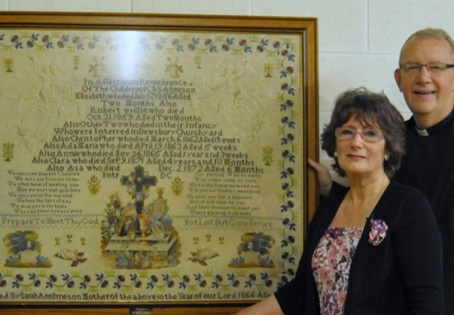 Journalist Margaret Watson is pictured with the Rev Canon Kevin Partington and the restored tapestry.  Picture by Mike Clark.