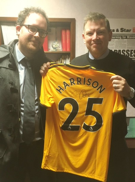 Keith Harrison receives his signed shirt from Express & Star sports writer Tim Spiers.