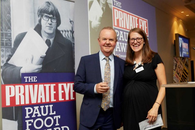 Emily Dugan receives the prize from Private Eye editor Ian Hislop