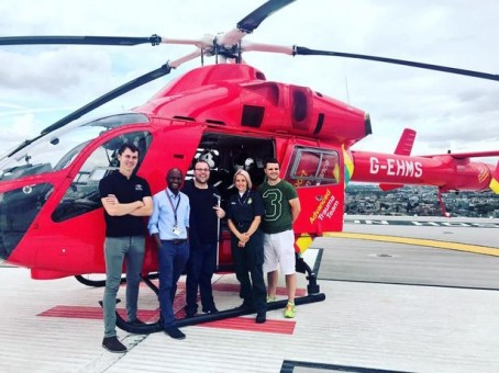 Gary, centre, with paramedics who saved his life