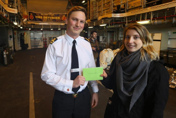Lizzie presents Lt Wilinson with the card