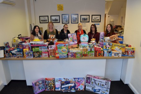 Goole Times staff and children's centre volunteers with some of the donations