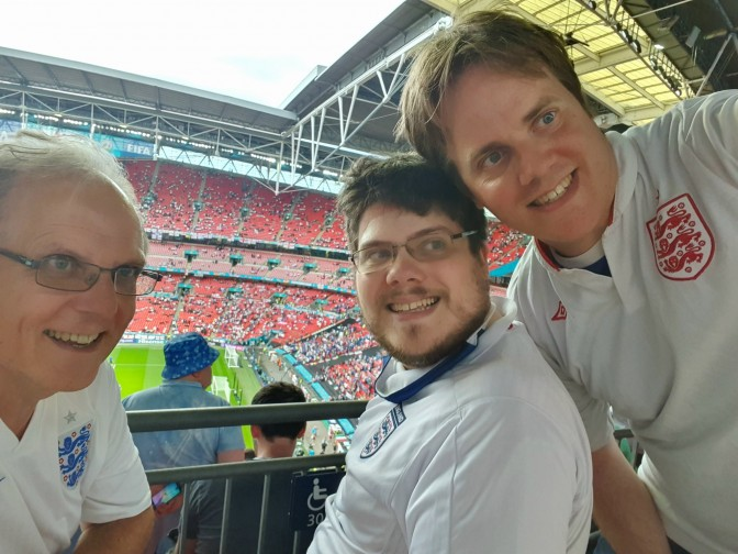 Graham, left, with his sons Tim and Martin at Wembley