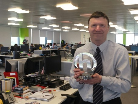 Greg Wright pictured with his award