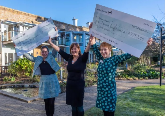 YEP editor Hannah Thaxter, centre, presented cheques with the latest proceeds to representatives of the two hospices in January