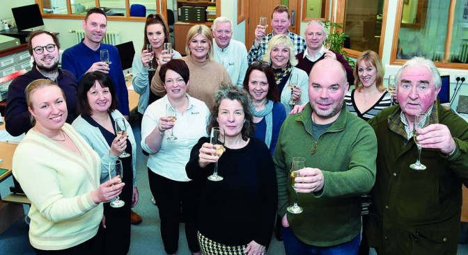 Herald staff celebrate the deal with new owner Andy Barr, pictured front in green