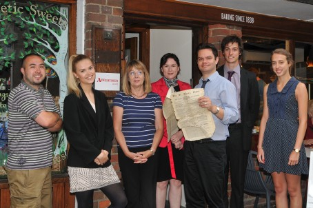 Members of the Herts Advertiser team including editor Matt Adams, pictured holding a copy of its first edition from 1855