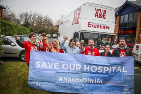 Examiner editor Roy Wright , third right, with staff and members of protest group #HandsOffHRI with the battle bus