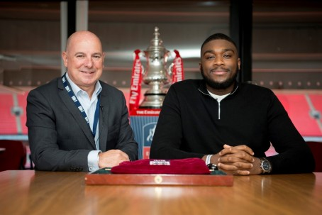 Samuel, right, at the FA Cup draw with the FA's director of professional game relations, Andy Ambler.