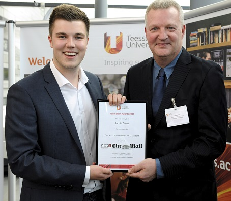 Jamie Crow, left, is presented with his prize by journalism lecturer Paul Bailey.