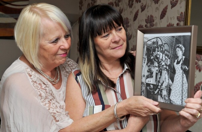 Sisters Wendy Chater, left, and Jane Lloyd with the picture of their mother Alice Griffiths