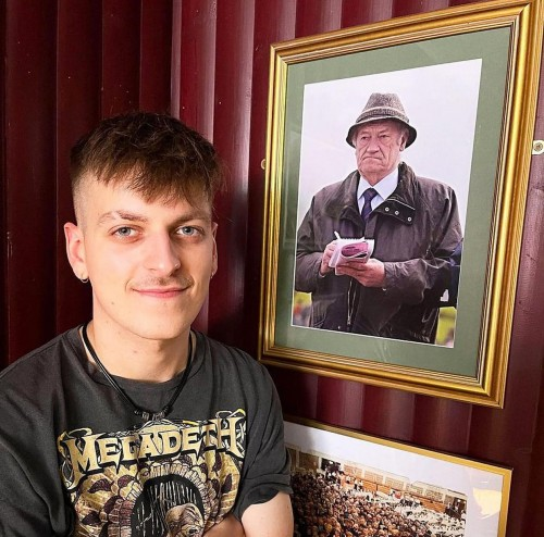 Henry Wormell in the bar with the photo of his grandfather Jimmy Walker
