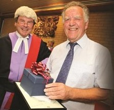 John Hoskins is presented with gifts by Judge Peter Ralls QC and is also pictured in his younger days.