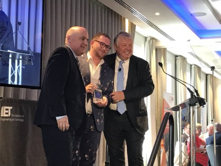 Josh Parry receives the Young Journalist of the Year prize from HoldtheFrontPage publisher Paul Linford, left, and awards presenter Nick Ferrarri, right