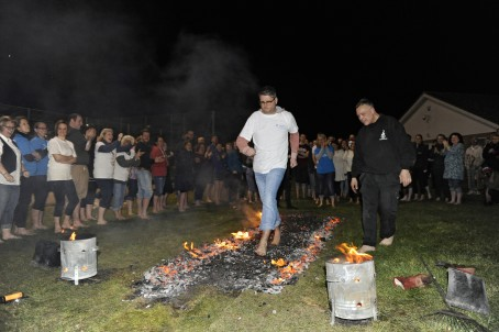 Leo Whitlock takes part in the firewalk.  Picture: Tony Flashman