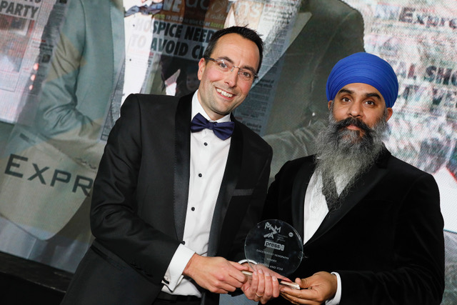 Martin Wright, editor of the Express & Star, receives the Newspaper of the Year (Daily) trophy from headline sponsor Bobby Singh