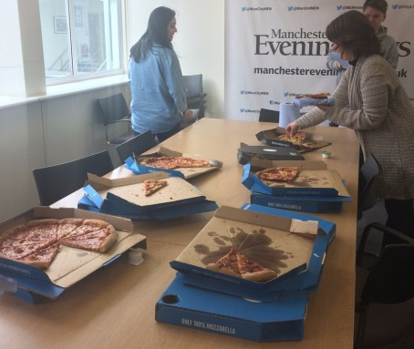 MEN staff with the pizza provided by the Boston Globe