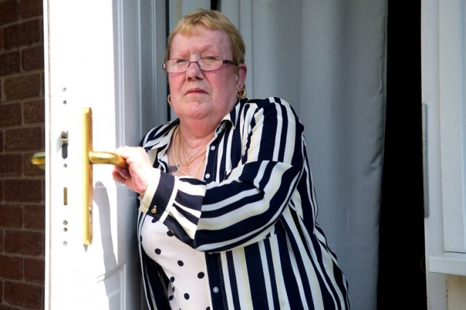 Theresa Whelan by the faulty door