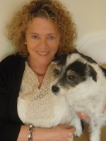 Former regional journalist Marjory McGinn with her dog, Wallace, who also features in the book