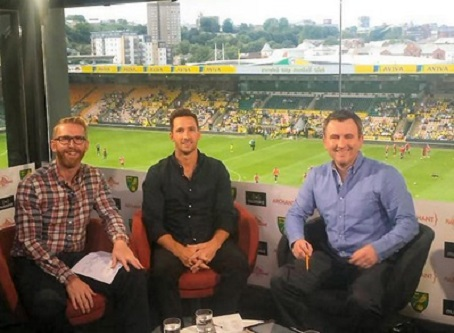 The Mustard commentary team at Carrow Road, pictured from left, Adam Drury, Mike Sewell and Iwan Roberts.