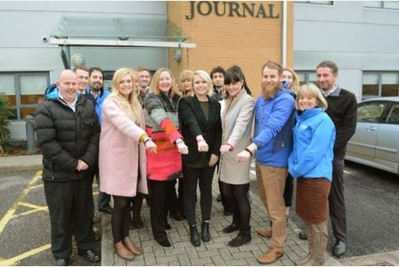 North Devon Journal staff sporting the bands outside their offices