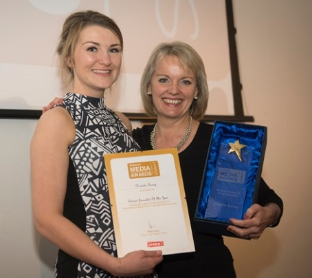 Natasha Turney, left, receives her award from BBC Midlands Today presenter Mary Rhodes.