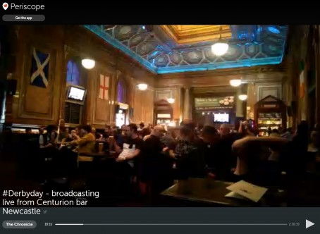 A screenshot from the live stream of fans watching the match in a pub in Newcastle