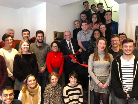 Arthur Edwards, pictured with the scissors, opens the new News Associates office