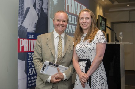 Emma Youle, right, receives last year's award from Private Eye editor Ian Hislop