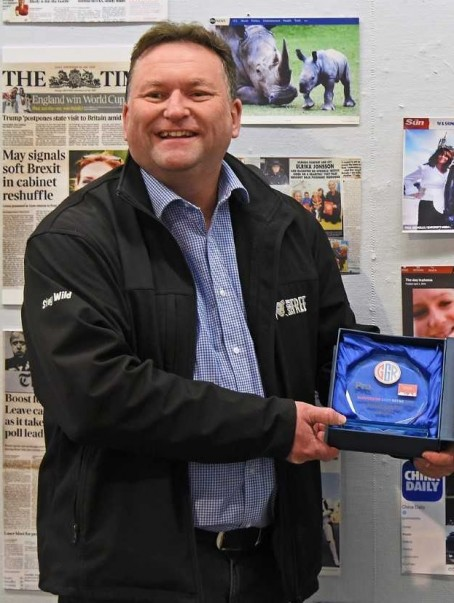 Paul Nicholls with his award