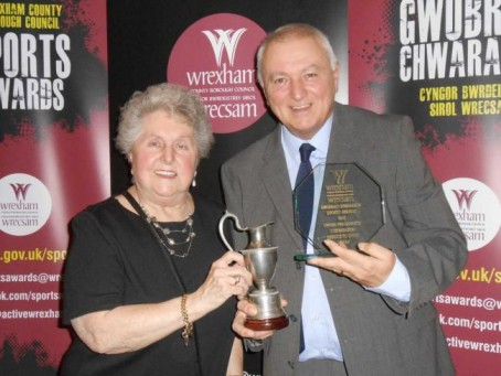 Phil Jones receives his award from Sheila Griffiths
