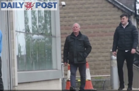 A still from the video showing Mr Roberts, pictured left, with the defendant