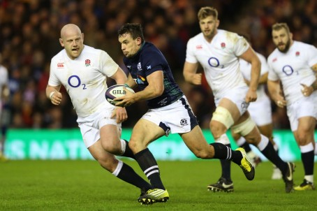 Scotland's John Hardie is pursued by English players in the recent Calcutta Cup match