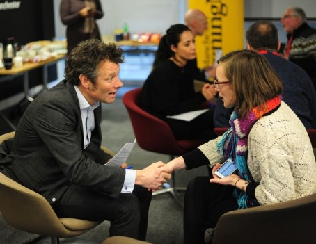 MEN digital development editor Seb Ramsay, left, talks to a community group volunteer at one of the events