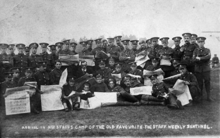 An archive photo of soldiers reading The Sentinel during the First World War