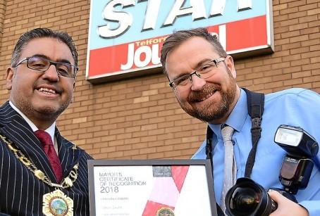 Cllr Mehta, left, presents Steve Leath with the award
