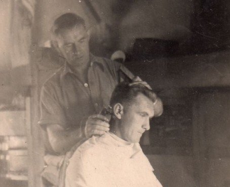 Roger Guttridge's father Tom receives a haircut during his army days