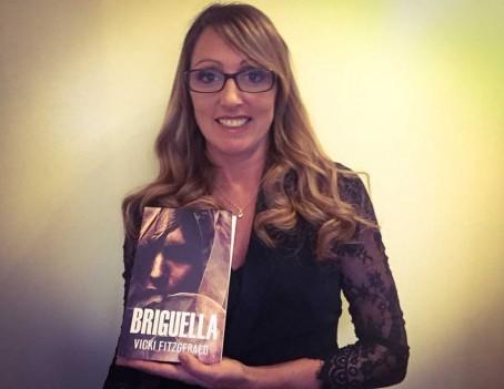 Vicki FitzGerald with her book, Briguella